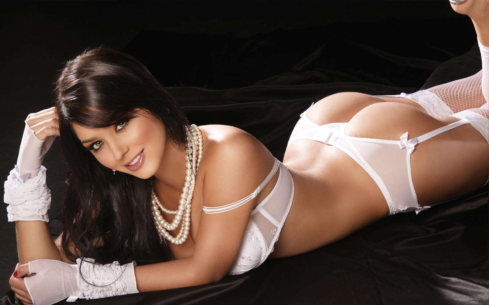 Beautiful dark haired siren in white lingerie