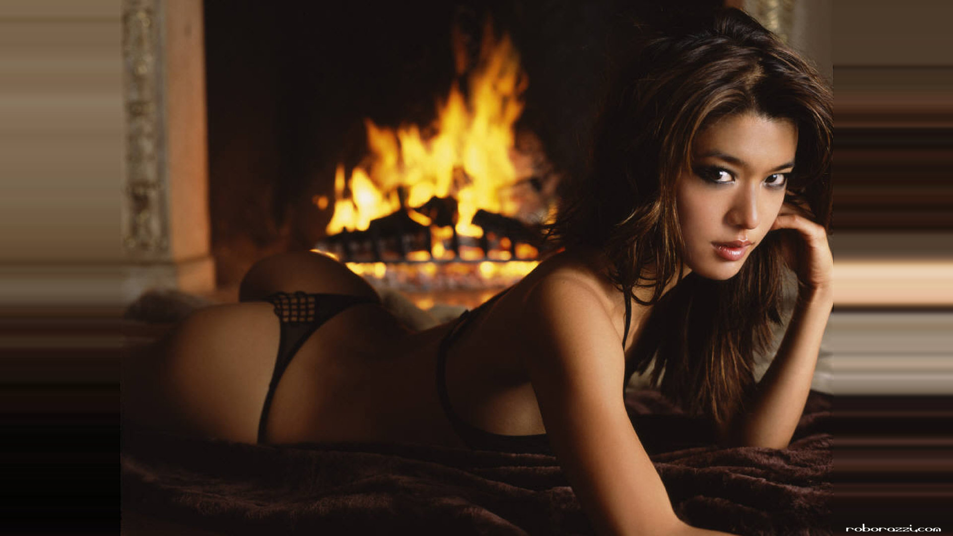 Grace Park in a thong in front of a fire