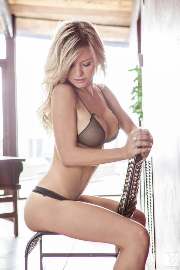 Sexy Blonde sitting on a chair
